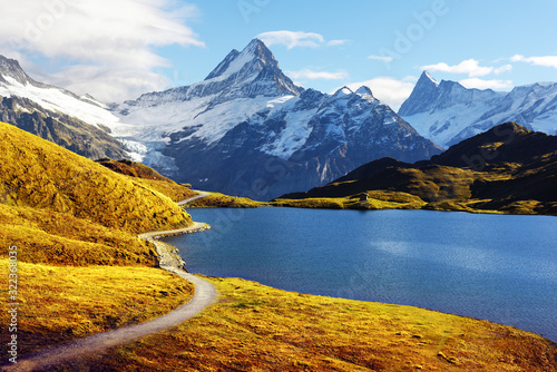 Fototapeta Picturesque view on Bachalpsee lake in Swiss Alps mountains. Snowy peaks of Wetterhorn, Mittelhorn and Rosenhorn on background. Grindelwald valley, Switzerland. Landscape photography obraz