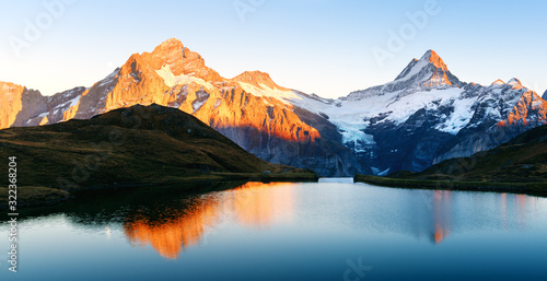 Fototapeta Bachalpsee lake with reflection in Swiss Alps mountains. Glowing snowy peaks on background. Grindelwald valley, Switzerland. Landscape photography obraz