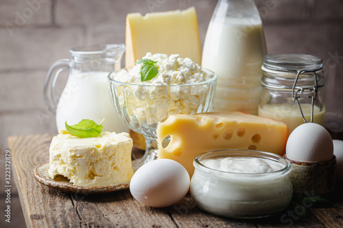 Fototapeta Fresh dairy products, milk, cottage cheese, eggs, yogurt, sour cream and butter on wooden table obraz