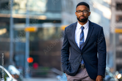 Obraz Stylish handsome modern business executive, african american banker, financial representative, suit and tie with smart glasses - fototapety do salonu