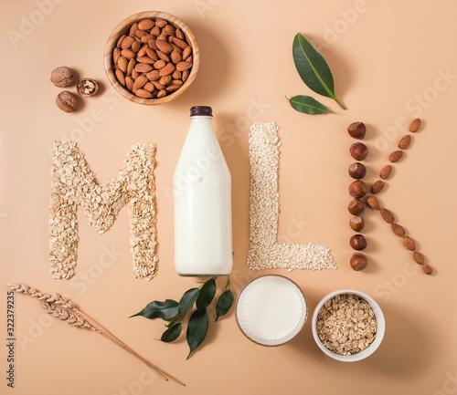 Plant based vegan milk, healthy alternative drink in bottle on wooden background Wallpaper Mural