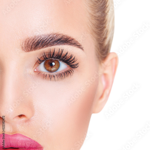 Close-up shot of young woman looks in camera. Wallpaper Mural