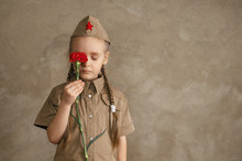 Little Girl With Flowers On Th...
