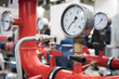 canvas print picture - Close up of manometer, pipe, flow meter, water pumps and valves of heating system in a boiler room