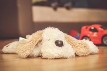 Closeup Shot A Plush Dog Lying...
