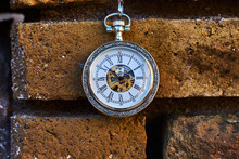Vintage Pocket Watch On A Yell...