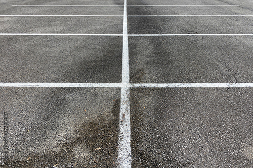 detailed view of parking spaces and lines on asphalt and Canvas Print