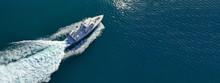 Aerial Drone Ultra Wide Photo Of Motorboat Cruising In Mediterranean Bay