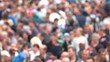 Blurred crowd of people at the stadium. Background of defocused and blurred crowd of people walking on busy street.
