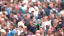 Blurred Crowd Of People At The...