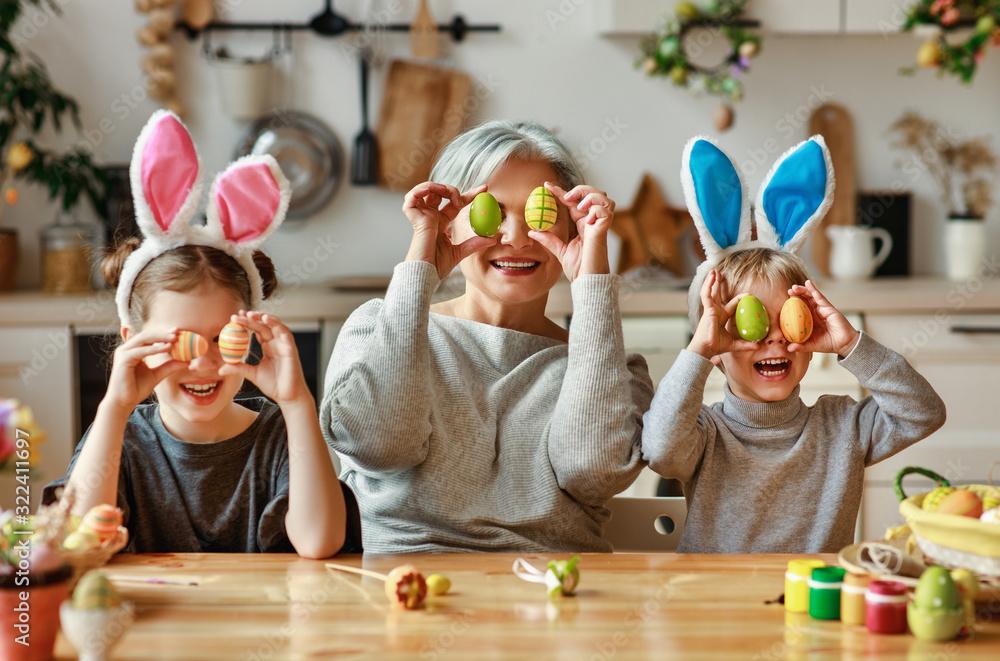 Fototapeta Happy easter! family   grandmother and children grandchildren paint eggs for holiday.