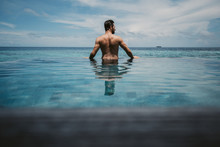 Rear View Of Man Relaxing In I...