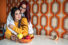 Portrait Of Two Teenage Girls At Home