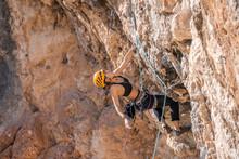 Woman Climbing At Rock Face