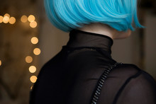 Young Woman Wearing Blue Wig