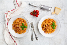 Plates Of Spaghetti With Tomato Sauce, Parmesan Cheese And Basil