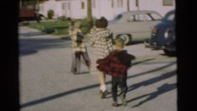 CHATHAM NEW JERSEY-1951: Three Kids Run Towards Man Driving Black Car On A Bright Sunny Day