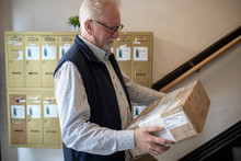 Senior Man With Package At Apa...