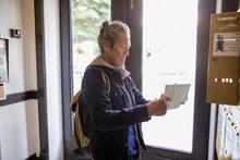 Senior Man Checking Mailbox In...