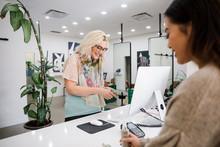 Customer Buying Hair Product F...