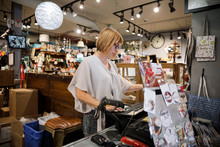 Woman Working In Gift Shop