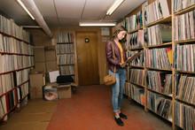 Woman Browsing Vinyl In Indepe...