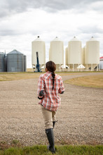 Female Farmer Walking Toward S...