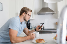 Young Man Leaning On Kitchen C...