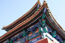 Low Angle Shot Of An Eave With A Chinese Traditional Colorful Decoration