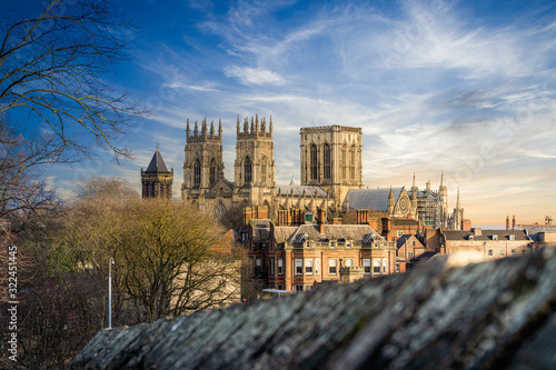 York Minster Cathedral with blue sky sunshine and castle walls