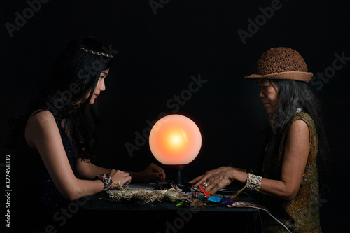 Portrait of  two fortuneteller with   tarot cards on wooden table Canvas Print