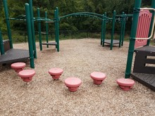 Play Structure With Green Bars And Red Stepping Stones