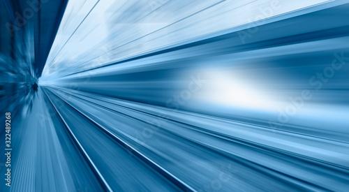 Cuadros en Lienzo High speed train runs on rail tracks . Train in motion.