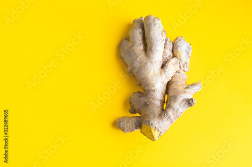 Fotografie, Obraz Ginger root on bright yellow background