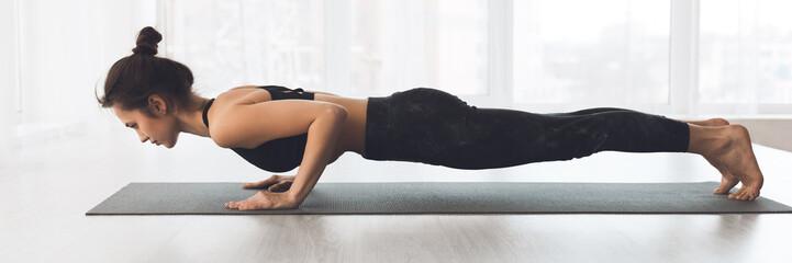 Fototapeta na wymiar Woman doing plank exercise or push ups