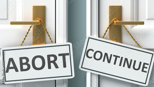 Abort or continue as a choice in life - pictured as words Abort, continue on doo Canvas Print