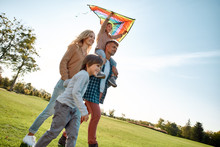 Caring. Honesty. Respect. Responsibility. Happy Family Playing A Kite. Outdoor Family Weekend