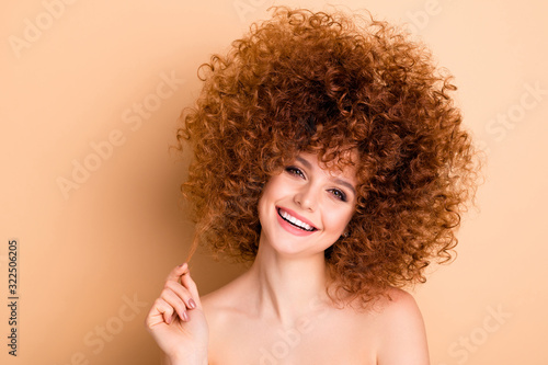 Obraz Close up photo beautiful she her no clothes lady curls fashion finished procedure stylist perms roller curlers hold wind up one curl finger look perfect condition isolated beige pastel background - fototapety do salonu