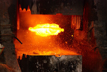 Metal Forging. Hydraulic Hammer Shapes The Red Hot Billet. The Production Of High Tech Parts