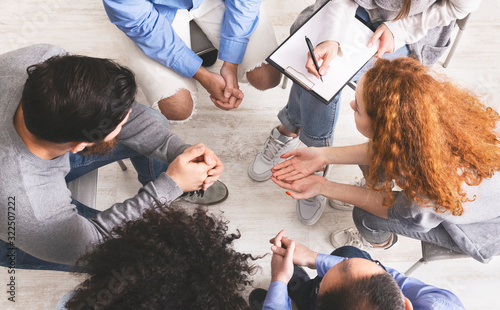 Photo People sharing their problems at discussion group meeting, top view