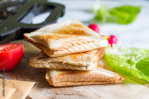 Toast with toaster sandwich maker  breakfast concept and ingredients Fototapete