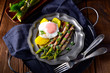 Leinwanddruck Bild delicious green asparagus wrapped in bacon and egg