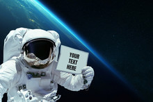 Spaceman In Open Space Shows A...