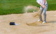 Golf Coach Hitting Ball On San...