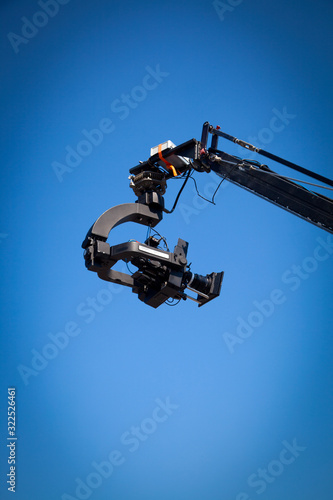 Image of a jib camera or camera crane with sky background Wallpaper Mural