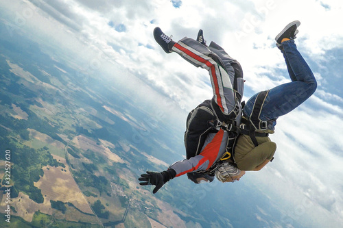 Fotografie, Obraz Skydiving tandem in a free fall