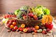 Leinwandbild Motiv wicker basket with fruit and vegetable