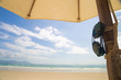 Under Umbrella On Beach On Summer Holidays Vacations