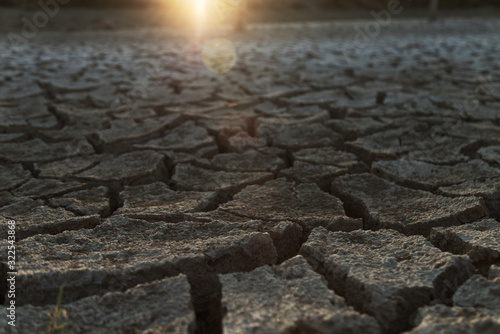 Dry soil in the sunset light; cracked soil texture Canvas Print