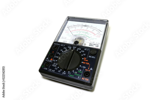 Analog black multimeter Laying on a white background Canvas Print